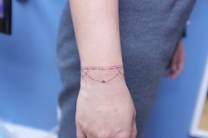 bracket tattoo